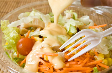 Closeup of take away bowl with fast food salad