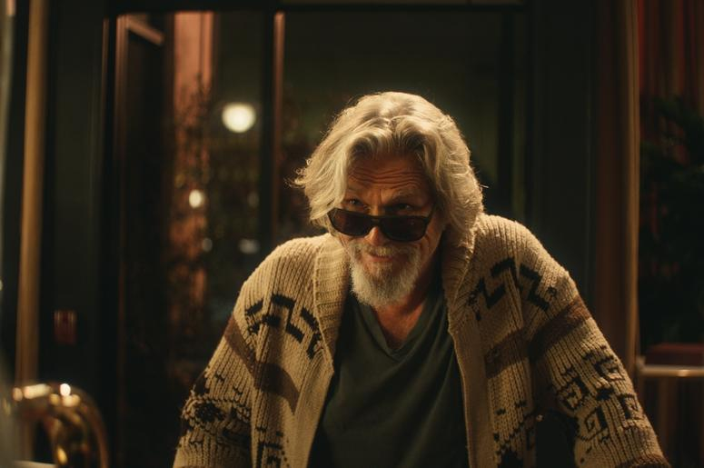 This undated image provided by Stella Artois shows a scene from the company's Super Bowl spot with Jeff Bridges. Star power abounds in this year's Super Bowl ads. Sarah Michelle Gellar, for instance, is making a horror movie parody for Olay, while Jeff Br