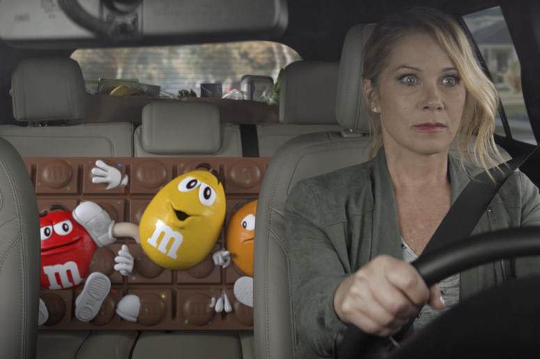 This undated image provided by M&M'S shows a scene from the company's 2019 Super Bowl NFL football spot starring Christina Applegate. M&M's enlisted actress Christina Applegate for its spot. (M&M'S via AP)