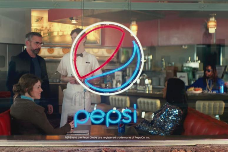 This screen grab from video provided by PepsiCo shows an image from the company's 2019 Super Bowl NFL football spot featuring Steve Carell, Cardi B and Lil Jon. Star power abounds in this year's Super Bowl ads. (PepsiCo via AP)