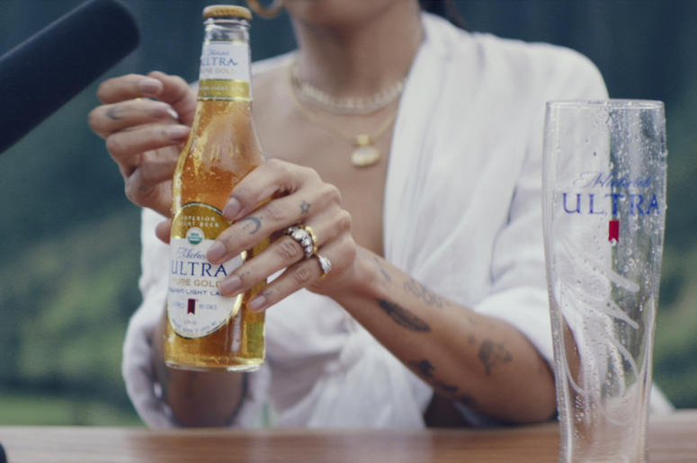 This undated image provided by Michelob ULTRA Pure Gold shows a scene from the company's 2019 Super Bowl NFL football spot starring Zoe Kravitz. (Michelob ULTRA via AP)