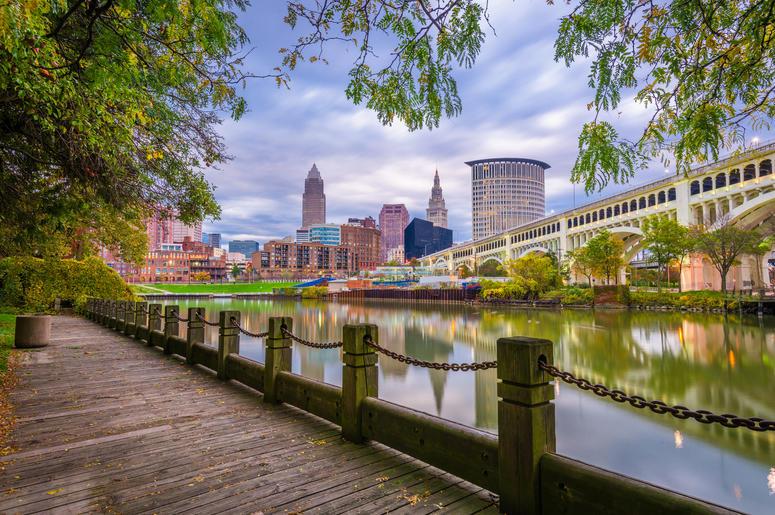 Cleveland, Ohio, USA downtown skyline on the Cuyahoga River at dusk.