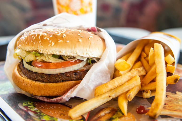 RICHMOND HEIGHTS, MO - APRIL 01: In this photo illustration, an 'Impossible Whopper' sits on a table at a Burger King restaurant on April 1, 2019 in Richmond Heights, Missouri. Burger King announced on Monday that it is testing out Impossible Whoppers, ma