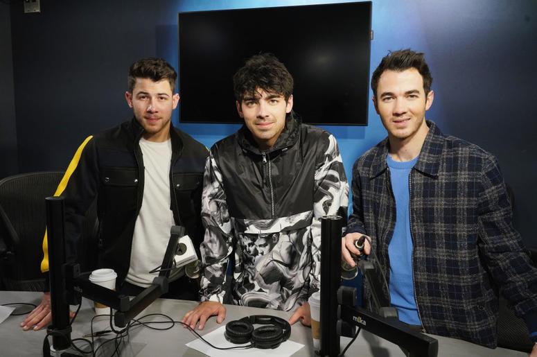 Nick Jonas, Joe Jonas and Kevin Jonas of The Jonas Brothers visit the SiriusXM studios on March 1, 2019 in New York City