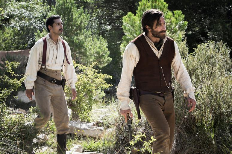 """Riz Ahmed (left) stars as """"Morris"""" and Jake Gyllenhaal (right) stars as """"Hermann Kermit Warm"""" in Jacques Audiard's THE SISTERS BROTHERS, an Annapurna Pictures release."""