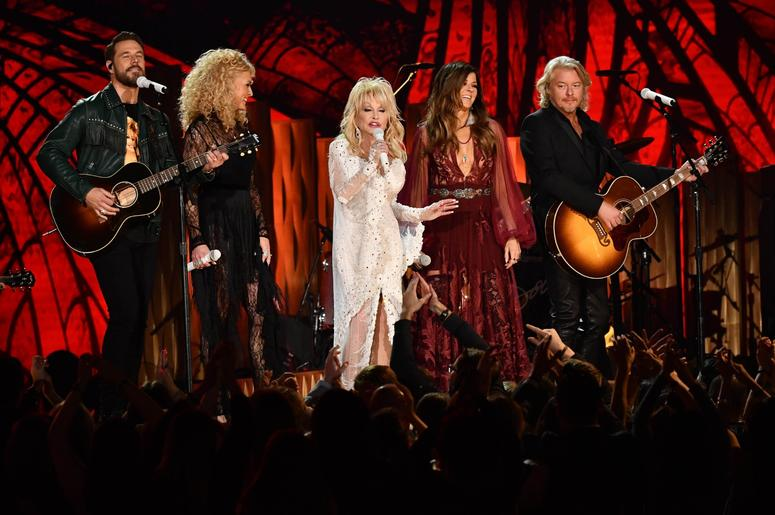 """February 10, 2019; Los Angeles, CA, USA; (From left) Katy Perry, Dolly Parton and Kacey Musgraves sing \""""Here you come again\"""" as part of a tribute to Dolly Parton during the 61st Annual GRAMMY Awards on Feb. 10, 2019 at STAPLES Center in Los Angeles, Cal"""