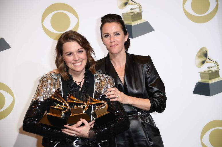 February 10, 2019; Los Angeles, CA, USA; Brandi Carlile, left and Catherine Shepherd pose with her awards for Best Americana Album for 'By the Way, I Forgive You', Best American Roots Song for 'The Joke' and Best American Roots Performance for 'The Joke'
