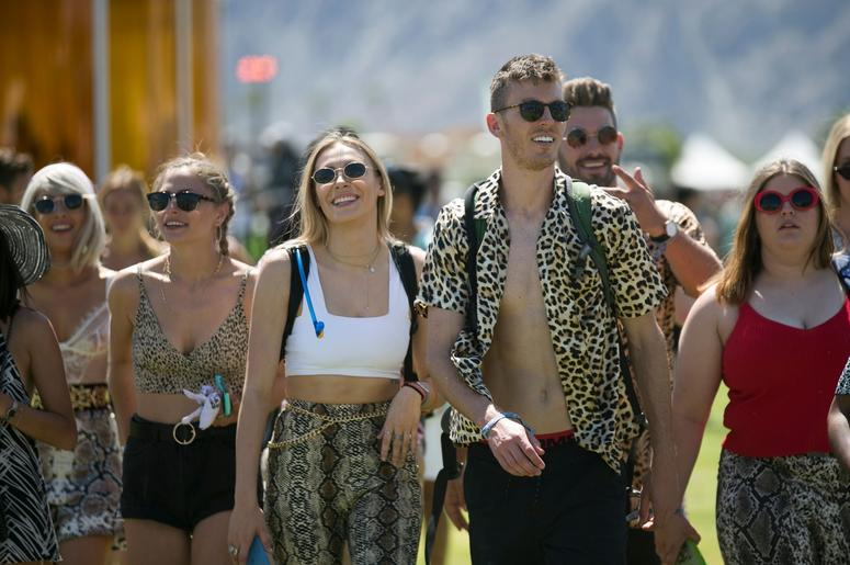 Festival goers walk on the grounds at the Coachella Valley Music and Arts Festival in Indio, Calif. on Fri. April 12, 2019. Coachella 2019