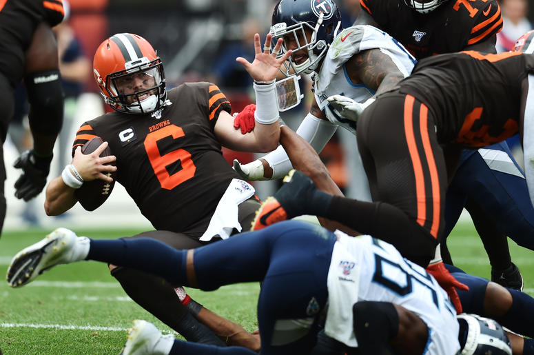 Sep 8, 2019; Cleveland, OH, USA; Cleveland Browns quarterback Baker Mayfield (6) is sacked by Tennessee Titans linebacker Cameron Wake (91) during the second half at FirstEnergy Stadium. Mandatory Credit: Ken Blaze-USA TODAY Sports