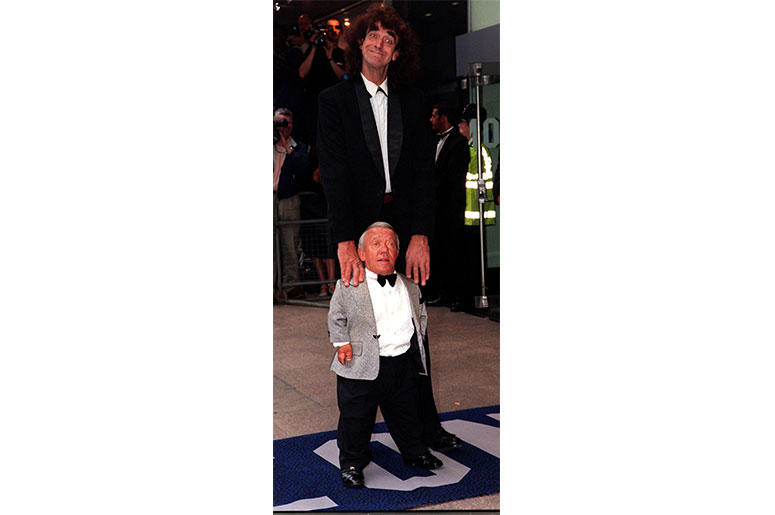 7/14/1999 - File photo dated 14/07/99 Peter Mayhew, who played Chewbacca and Kenny Baker who palyed R2D2 arriving for the Royal Film Performance of Star Wars : Episode 1 The Phantom Menace at the Odeon Leicester Square in London, as Mr Baker has died at t