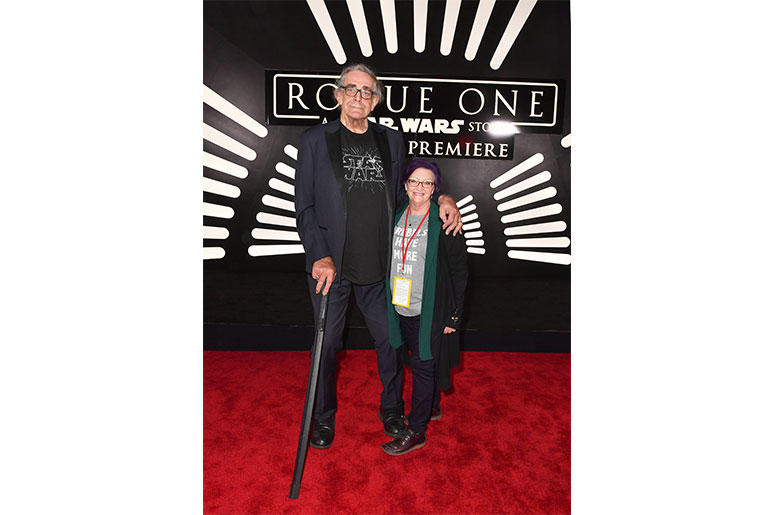 "HOLLYWOOD, CA - DECEMBER 10: Actor Peter Mayhew (L) and Angie Mayhew attend The World Premiere of Lucasfilm's highly anticipated, first-ever, standalone Star Wars adventure, ""Rogue One: A Star Wars Story"" at the Pantages Theatre on December 10, 2016 in Ho"
