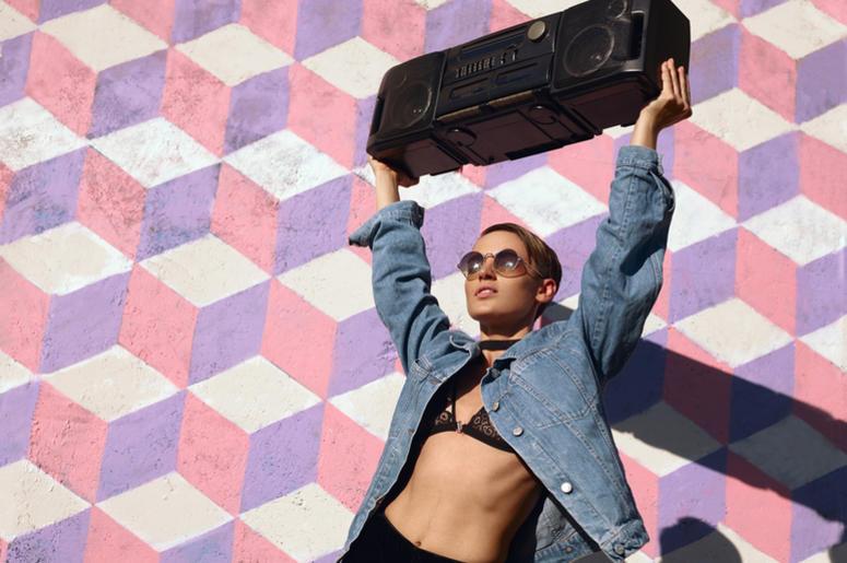 Stylish girl with boombox
