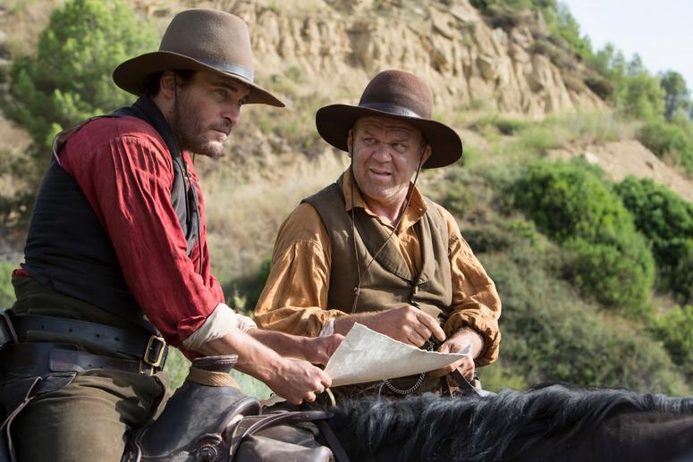 """Joaquin Phoenix (left) stars as """"Charlie Sisters"""" and John C. Reilly (right) stars as """"Eli Sisters"""" in Jacques Audiard's THE SISTERS BROTHERS, an Annapurna Pictures release."""
