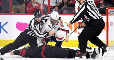 Alex Ovechkin of the Washington Capitals knocks out Andrei Svechnikov of the Carolina Hurricanes during Game 3 of the first round of the 2019 NHL playoffs.