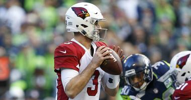 Dec 30, 2018; Seattle, WA, USA; Arizona Cardinals quarterback Josh Rosen (3) looks to pass against the Seattle Seahawks during the first quarter at CenturyLink Field.