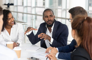 man talking at table in office