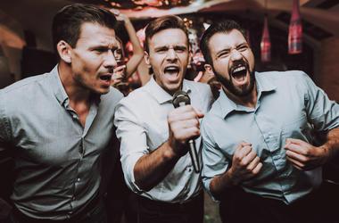 3 guys doing karaoke