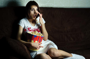 woman watching movie with popcorn