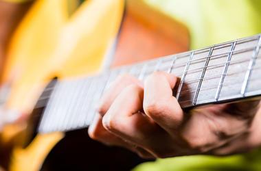 guitar-hands-dreamstime_xxl_44838820.jpg