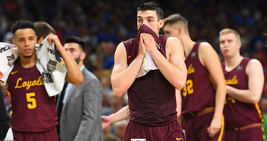 Loyola's Clayton Custer and the Ramblers walk off the Final Four floor.