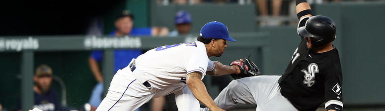 White Sox catcher Welington Castillo is tagged out by Royals third baseman Cheslor Cuthbert.