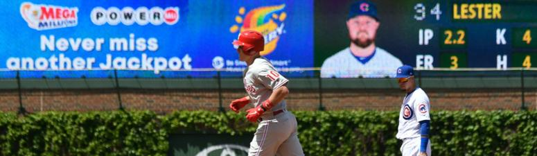Phillies catcher J.T. Realmuto rounds the bases after homering against the Cubs.