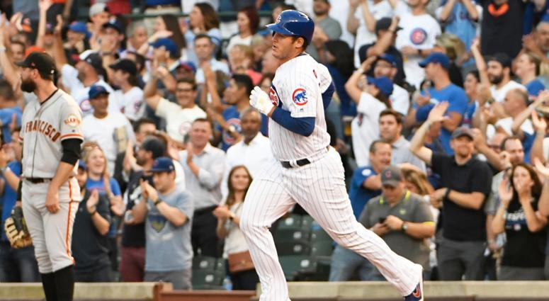Cubs first baseman rounds the bases after homering against the Giants.