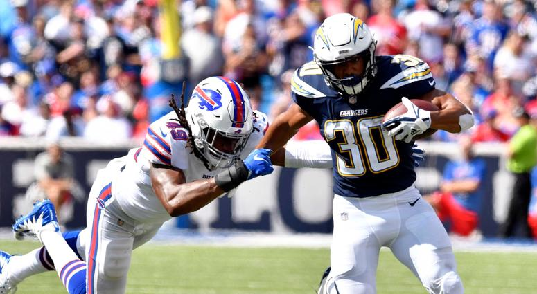 Chargers running back Austin Ekeler, right