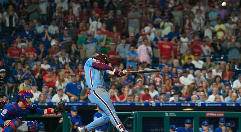 Phillies outfielder Bryce Harper hits a walk-off grand slam against the Cubs.