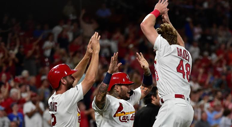 Cardinals center fielder Harrison Bader (48) celebrates with catcher Yadier Molina (4) and shortstop Paul DeJong (12).