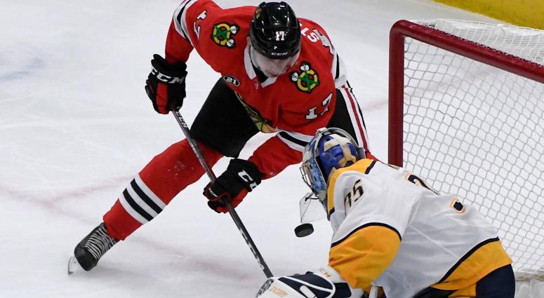 Predators goalie Pekka Rinne (35) defends against Blackhawks center Dylan Strome (17).