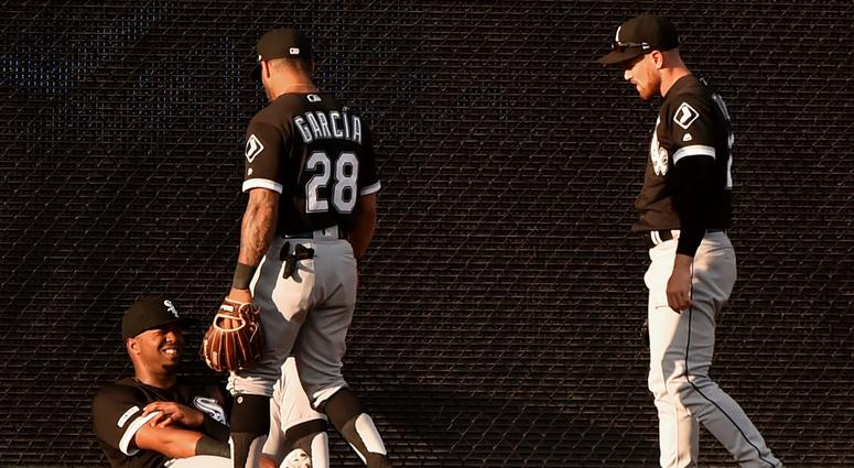 Eloy Jimenez, left, reacts after colliding with White Sox teammate Charlie Tilson.