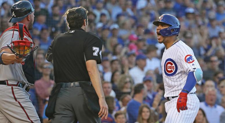 Cubs catcher Willson Contreras, shouts at Braves catcher Tyler Flowers.