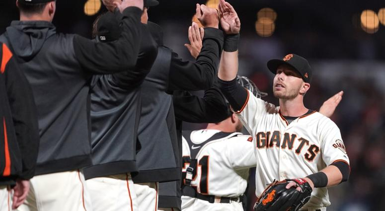 Austin Slater, right, and the Giants celebrate a come-from-behind win against the Cubs.