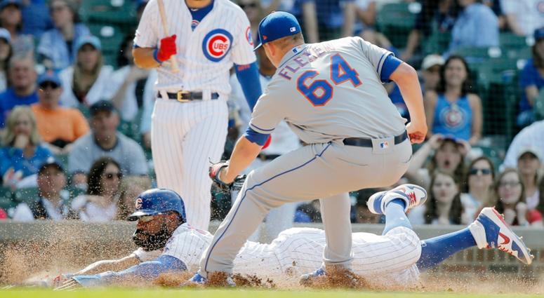 Cubs right fielder Jason Heyward (22) steals home after a wild pitch.