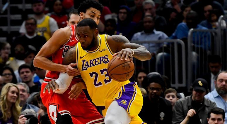 eedde04ac620 Lakers forward LeBron James drives on Bulls forward Otto Porter Jr.