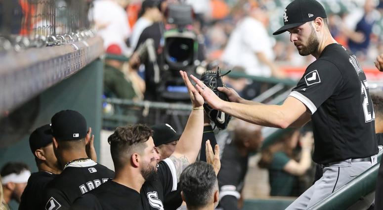 White Sox right-hander Lucas Giolito, right, receives congratulations from teammates.