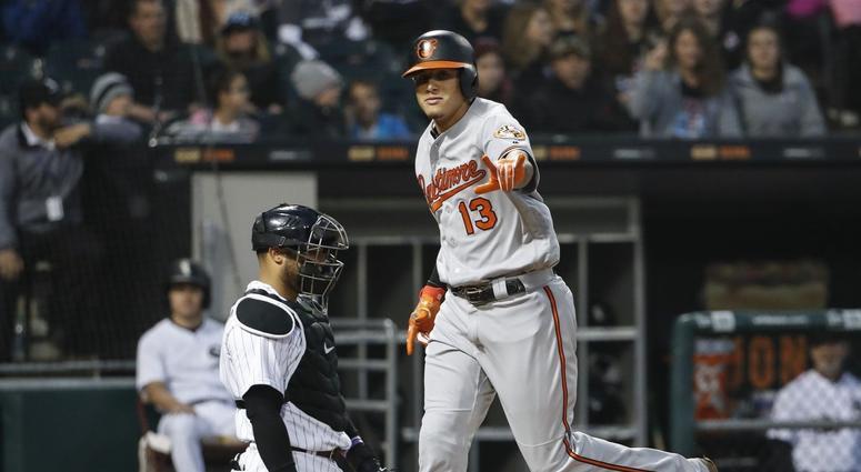 Orioles shortstop Manny Machado crosses home plate after homering.