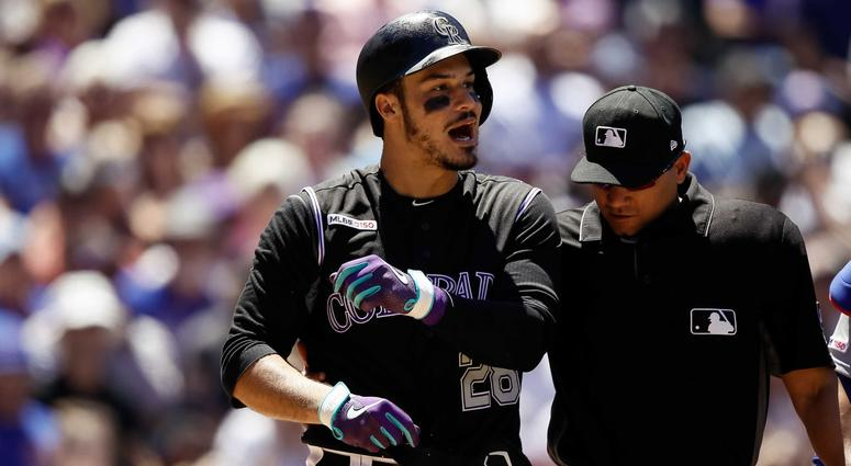 Rockies third baseman Nolan Arenado (28) reacts after being hit by a pitch by the Cubs.