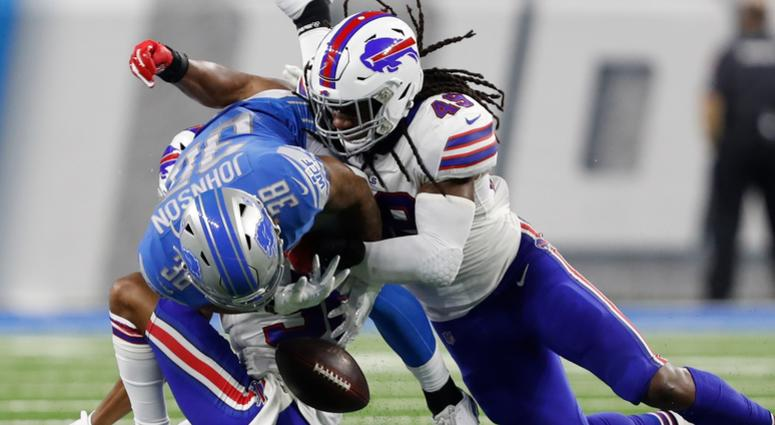 Lions running back Ty Johnson (38) fumbles the ball against Bills cornerback Kevin Johnson (36) and middle linebacker Tremaine Edmunds (49).