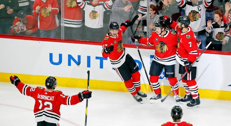 Blackhawks forward Dominik Kahun celebrates a goal against the Red Wings.