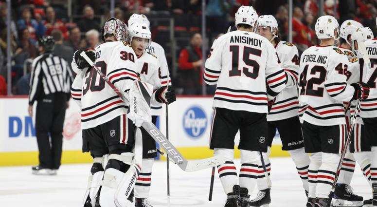 The Blackhawks celebrate after an overtime win against the Red Wings.