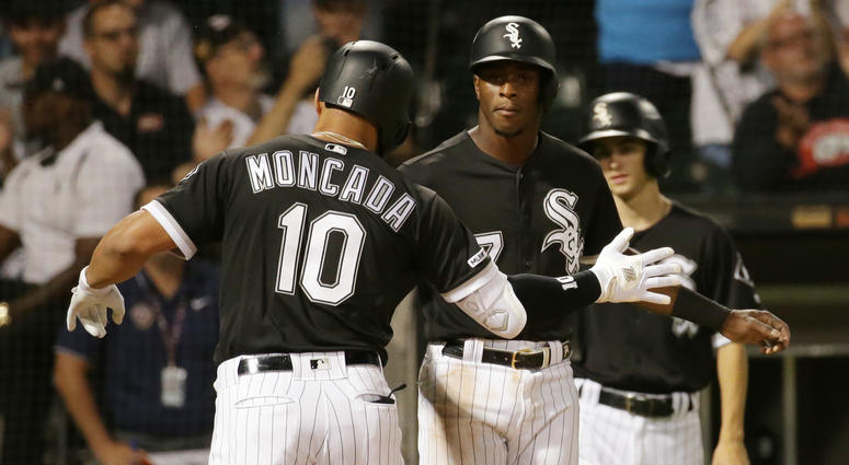 White Sox third baseman Yoan Moncada, left, and shortstop Tim Anderson