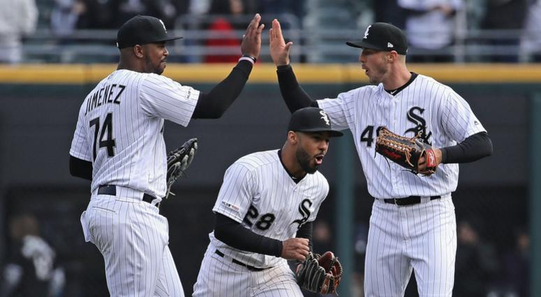 From left, Eloy Jimenez, Leury Garcia and Ryan Cordell celebrate the White Sox's win against the Mariners.