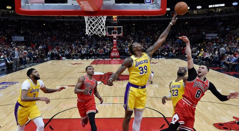 Lakers center Dwight Howard (39) blocks the shot of Bulls guard Zach LaVine (8).