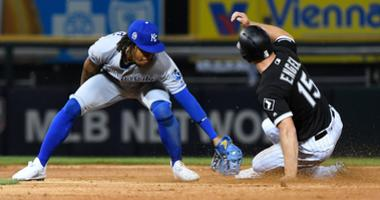 White Sox outfielder Adam Engel (15) steals second base ahead of a tag by Royals shortstop Adalberto Mondesi (27).