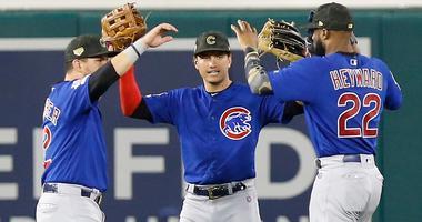 Cubs outfielders Kyle Schwarber (12), Albert Almora Jr. (5) Jason Heyward (22) celebrate. a win.