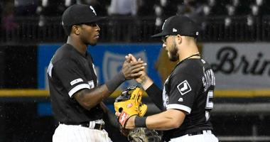 White Sox shortstop Tim Anderson, left, and second baseman Yolmer Sanchez celebrate a win.