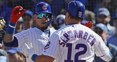 Kyle Schwarber is greeted by Cubs teamamte Javier Baez after homering against the Pirates.