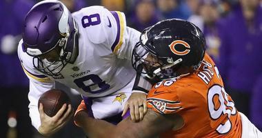 Bears defensive lineman Akiem Hicks sacks Vikings quarterback Kirk Cousins during a game at Soldier Field in 2018.
